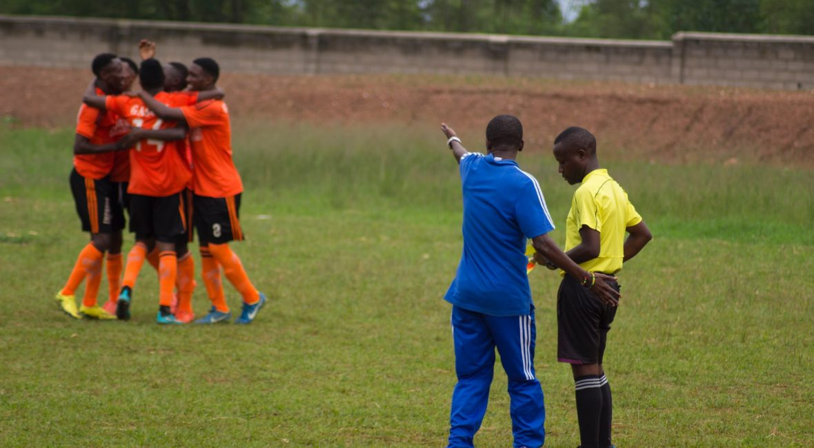 coach of football team complaining at the referee